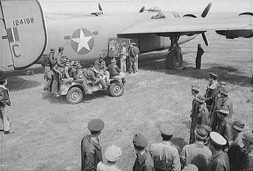 This photo is the B-24D,  'THE VULGAR VIRGIN'  -  SN #41- 24198  - 9th Air Force, 98th Bomb Group, 344th Bomb Squadron, flown by command pilot Lt. Wallace C. Taylor. Lt. Taylor, flying in the center of Flight Five, the last of the four flights behind Col. John Kane in 'Hail Columbia', entered a wall of smoke over White IV behind  'Hail Columbia' and several other B-24s.  When the small group of B-24s exited the smoke, 'THE VULGAR VIRGIN