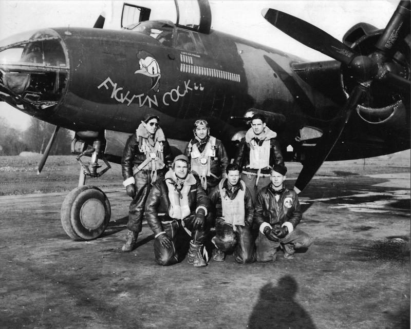 Captain Howard M. Posson (Back row, third from the left) with the crew of