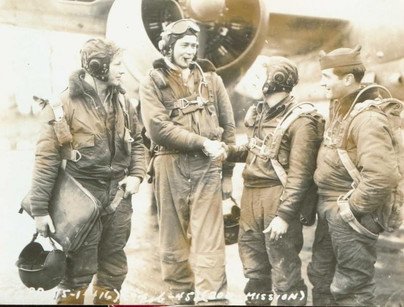 Combat Crew of the 416th BG - 671st Bomb Squadron - 9th AF on the occasion of the groups 200th combat mission Standing Left to Right: Richard C. Muir (B/N), David L. Willetts (P/Sqdn CO), Peter G Royalty (Sqdn B/N), John W. Rose (G)