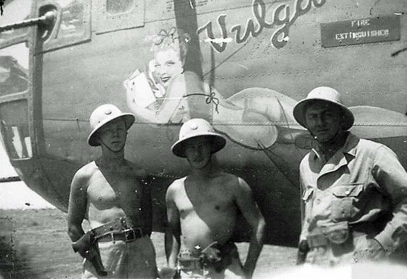 B-24D - 'The Vulgar Virgin'  -  #42-40608  - 8th Air Force -  93rd Bomb Group, and the 328th Bomb Squadron from Great Britain, brought down to Benghazi, Libya, for operations in the MTO, including Operation Tidal Wave.  Lt. James Marquis, navigator,  standing on the left.   1943