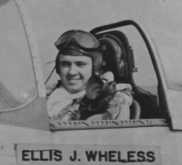 2Lt. Wheless in the cockpit of his P-51 fighter.