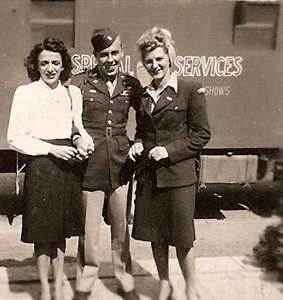 Lieutenant Sherman F Childers of the 67th Tactical Reconnaissance group with two ladies, possibly USO dancers.