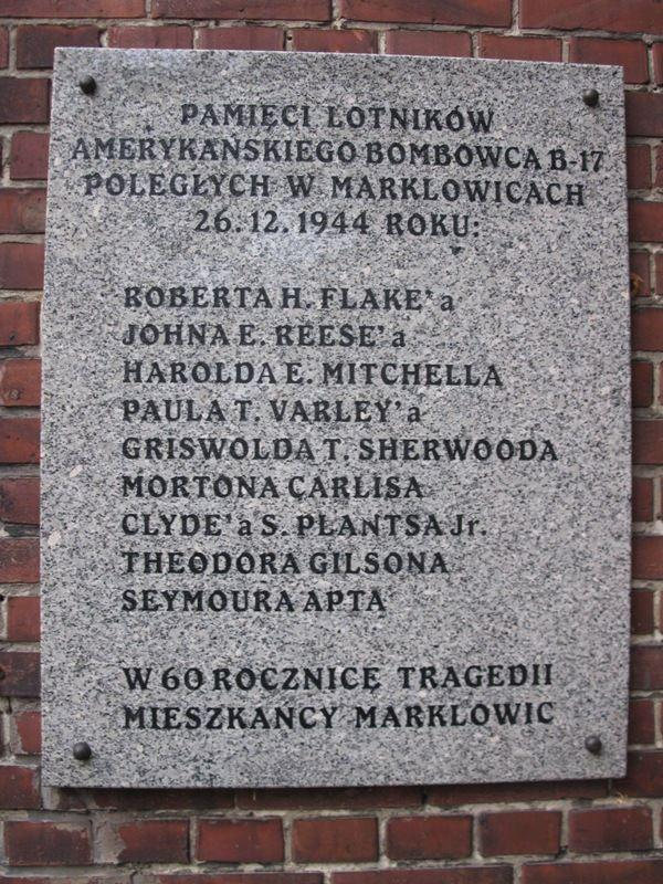 A commemorative plaque on the wall of a local church in Marklowice, Poland, where B-17G