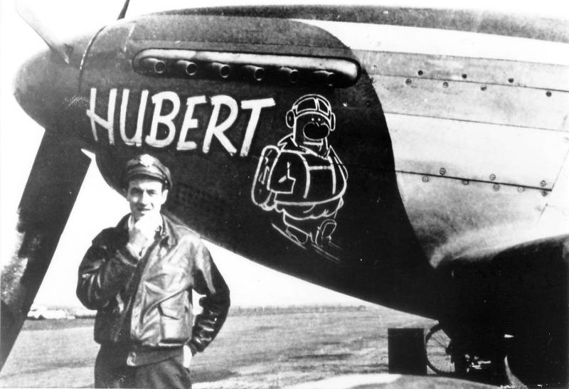 Captain Robert W Hopkins of the 369th Fighter Squadron in front of the second P-51D to be named