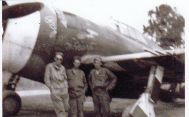 Staff Sergeant Stanley J Davis ,  Ernest Marshall and Raymond Rappold  ground crewmen of the 405th Fighter Group with a P-47 Thunderbolt (2Z-L) nicknamed