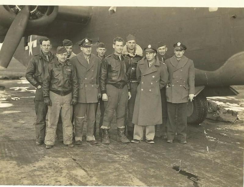 Crew #718 - Amos Sharretts Crew 466th BG - 787th BS  Standing Left to Right: Harold F Higgens (G), George Aeschbach (BTG), Alfred G. Nelson (TG), Robert D. Handley (B), W.P. Follis (FE), Amos B. Sharretts (P), William R. Don Carlos (G), Arthur J. Pierce (466th BG Commander), B. Androus (R/O), Dean O. Garvey (N)  Not in photo:  Frank S. Cohen (CP)  This photo was taken upon arrival at Attlebridge from the U.S. as the group moved overseas to begin combat operations.  Colonel Pierce chose this crew to fly over with and served as Co-Pilot on the trip displacing Frank Cohen who had to travel by sea.