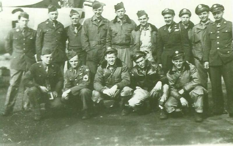 Crew # 583/496 Dwight I. Auman Crew 466th BG - 785th and 784th Bomb Squadrons This crew completed 13 missions with the 785th BS and 2 missions as a lead crew with the 784th BS before hostilities ended.  Standing Left to Right:  Unknown, Unknown, Robert Glass (Assistant Ground Crew Chief), Norbert Kosin (Ground Crew Chief), Billy Jones (WG),  Don D'Lugos (TG), Dwight Auman (P), Barrett Ring (B), Paul Goldstein (CP), Albert Johnson (WG)  Kneeling Left to Right:  Daniel O'Bryan (Camera Tech), James Kaspar (FE), Edward Conroy (N), Harry Schroeder (NG), Albert Johnson (WG)  This