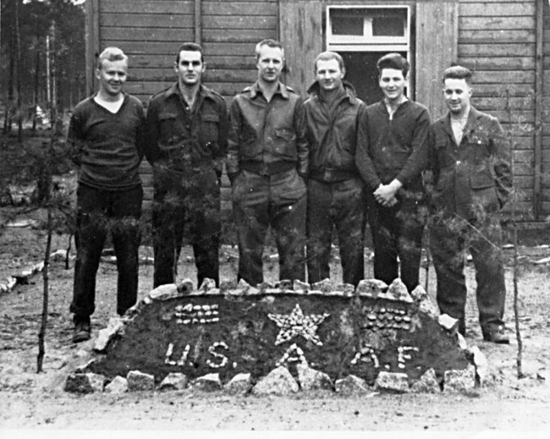 Prisoners of War of the 44th Bomb Group at Stalag Luft III with a USAAF insginia made of stones. Left to right : Bob Walker, Wayne Gotke, Bob McPhillamey, Bill Wockenfuss, Leo Frazier, John Mooney.