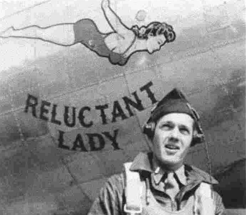 Unknown personnel next to Reluctant Lady nose art.