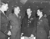 "Official USAAF photo. Original caption : ""Three of the many U.S. 8th Air Force fighter pilots who distinguished themselves in the great air battle over Germany on 2 November 1944 when 8th Fighters destroyed 130 enemy planes in the air and 25 on the ground, are shown with Lt. General Carl A. Spaatz, Commanding General of the U.S. Strategic Air Forces in Europe, after he presented Distinguished Service Crosses to them. Left to right: Lt. Col Robert P. Montgomery, Bethlehem, PA, who led eight North American P-51 Mustangs against 200 German fighters; Gen. Spaatz; Capt. Ray S. Wetmore, Kerman, Calif., whose six-plane section broke up a formation of thirty Germans; and capt. Donald S. Bryan, Paicines, Calif., who destroyed five enemy planes and damaged two others. England."""