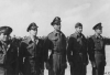 """Official USSAF photo. Original caption : Left to right : 1st Lt. Frank R. Hodges, Kosciusko, Miss.; 1st Lt. William E. Keefer, Torrance, Calif.; 1st Lt. Harold K. Kendall, Chariton, Iowa; 1st Lt. Earl C. Kent, Keene, Calif. And 1st Lt. Leland J. Rath, Almond, Wis., all of whom received Air Medals."""" [ Awards ceremony in North Africa – photo sent on 3 March 1943 through Evaluation Unit, AAF from 9th Combat Camera Unit, Cairo, Egypt. Lieutenants Hodges, Keefer, Kendall, Kent and Rath were all members of the 93rd Bomb Group. ]"""