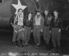 """Official USAAF photo – B-61690 AC  Original caption :  """"Crew of the Boeing B-17 Flying Fortress """"SKY WOLF"""" pose beside the plane. 303rd Bomb Group. England. 27 February 1943.""""  [ From left to right : Captain Samuel H. Anderson; Captain Carl H. Morales; Major Clemens K. Wurzbach; Captain Hubert E. Miller; 1st Lt Frank E. Zasadil."""