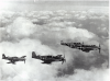 Over Cambridge in July, 1944:  Publicity photos to help sell war bonds.  Taken from the waist of a B-17.   E2-C Col. Tom Christian, E9-O Capt. Sam Wilkerson, E9-R 1Lt. Victor Bocquin, E9-D 1LT Robert Volkman.  (Photo courtesy of Robert Volkman 2003.)