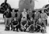 James R. Regan, Sr. pilot. a lieutenant at the time, is second person kneeling from the left.