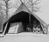 398th Bomb Group, 603rd Bomb Squadron, at Nuthampstead. Tent storing bombs and bomb paraphernalia (jack-trolleys and stands).