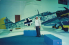 Major Jack C Price of the 78th Fighter Group with a BF 109 at the RAF Museum at Hendon, September 1995.  Handwritten caption on reverse: 'Major Jack Price, Colorado Springs, CO., Ace 5 Kills, 84th Fighter Squadron, 78th Group. Hendon Museum, London September, 1995. Hometown: Grand Junction CO'